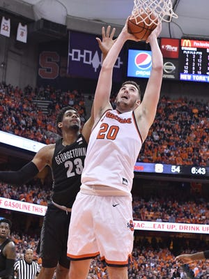 Syracuse Orange forward Tyler Lydon (20) shoots the ball as Georgetown Hoyas guard Rodney Pryor (23) defends during the second half at the Carrier Dome. Georgetown won the game 78-71.