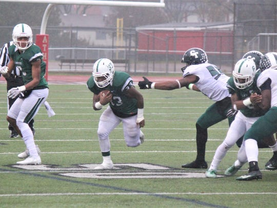 West Bloomfield fullback Shamar Dennis busts loose on a 54-yard gain in the fourth quarter, the Lakers' biggest gain of the day, as his team won the Division 1 semifinal over Detroit Cass Tech Saturday.