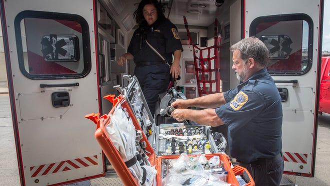 Rachel Clark and Greg Boucher with Delaware County EMS show different equipment that they stock on the ambulances to treat a wide variety of injuries. Mayor Dennis Tyler is considering creating a city-based ambulance service, which would take over duties normally done by the Delaware County EMS.