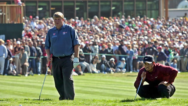 John Daly, left, and Tiger Woods assess their ball positions at 18, on the first hole of a sudden-death playoff during the final round of the American Express World Golf Championships at Harding Park in San Francisco, on Oct. 9, 2005. Woods won when Daly bogeyed the second hole.