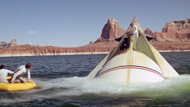 """Lake Powell near Page was an otherworldly stand-in for this scene from """"The Planet of the Apes."""" The 1968 sci-fi thriller starred Jeff Burton (from left), Robert Gunner and Charlton Heston (climbing out of the ship)."""