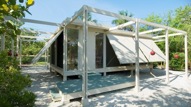 The Walker Guest House on Sanibel, created by architect Paul Rudolph. He designed the home with large wooden panels, controlled by counterweights that look like red cannonballs, which could be lowered over screened windows to seal the home or open it up to welcome Gulf breezes.