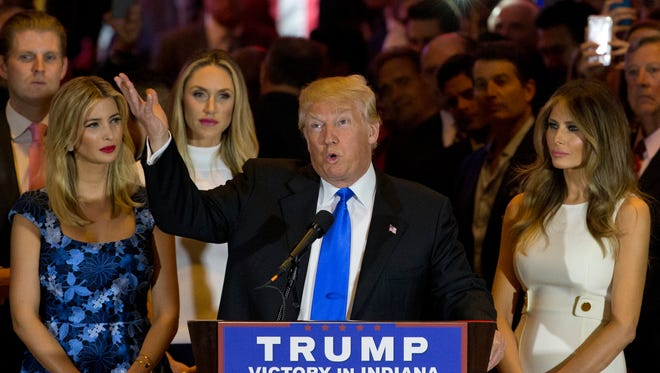 Republican presidential candidate Donald Trump is joined by his wife Melania, right, daughter Ivanka, left, and son Eric, background left, at a news conference this week in New York.