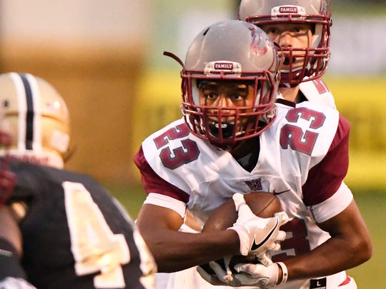 Westside's Paul Johnson (23) finds a gap in the Greer