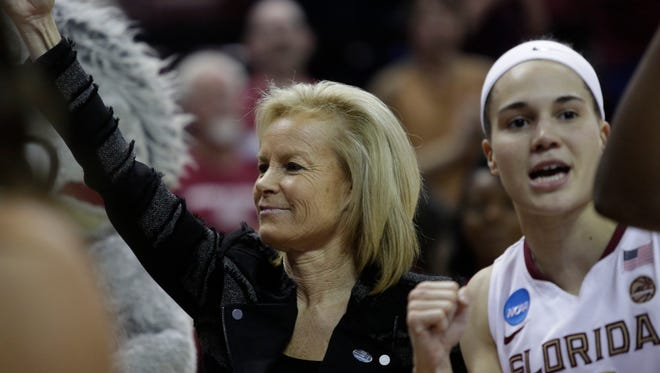 Coach Sue Semrau and Guard Brittany Brown sing Florida State's fight song after Brown's last game at the Donald L. Tucker Civic Center Sunday, a 77-55 defeat of Missouri that puts FSU in the sweet 16 of the NCAA tournament.