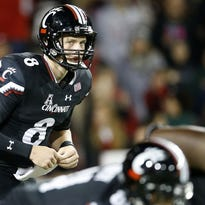 Redshirt freshman Hayden Moore led UC to an upset of the Miami Hurricanes in his first college start at quarterback.