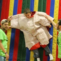 Families enjoy free food, games and more at last year's Good News Spectacular.