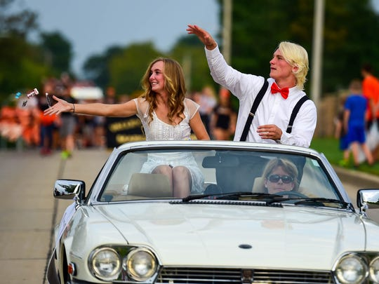 Homecoming candidates Genny Wyckoff and Rocky Lombardi wave to fans on Sept. 22 during the Valley homecoming parade and party.