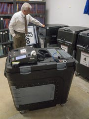 Westland City Clerk Richard LeBlanc with the new voting