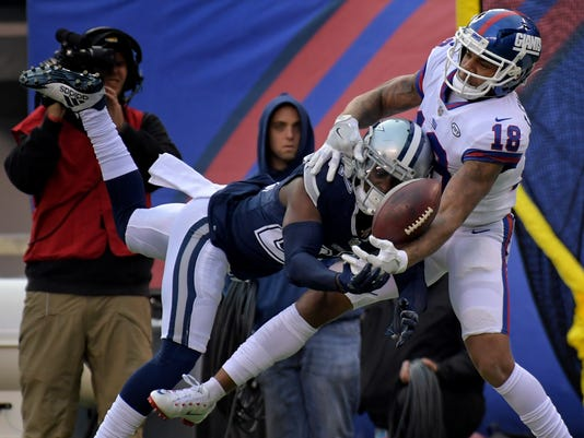 New York Giants wide receiver Roger Lewis (18) breaks up a pass intended for Dallas Cowboys cornerback Jourdan Lewis (27) during the third quarter of an NFL football game, Sunday, Dec. 10, 2017, in East Rutherford, N.J. (AP Photo/Bill Kostroun)