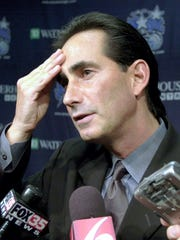 Former Orlando Magic General Manager John Gabriel fields a question in 2003 about an upcoming draft during a meeting with the press at the Magic training facility in Orlando, Florida.