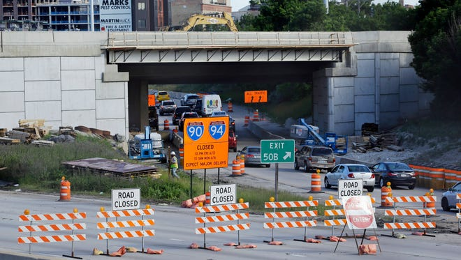 In this June 14, 2014 file photo, inbound Kennedy Expressway traffic is diverted onto the Ohio Street off ramp at a road construction project in Chicago. (AP Photo/Nam Y. Huh, File)
