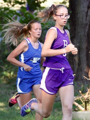 Waynesboro's Ashlyn Beck, right, gains ground on a