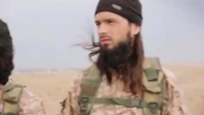 "This still image taken from an undated video published on the Internet by the Islamic State and made available on Sunday, Nov. 16, 2014, shows a militant that the French government say is Frenchman Maxime Hauchard. Interior Minister Bernard Cazeneuve urged young people in France to ""open your eyes to the terrible reality"" of the militant group. (AP Photo)"