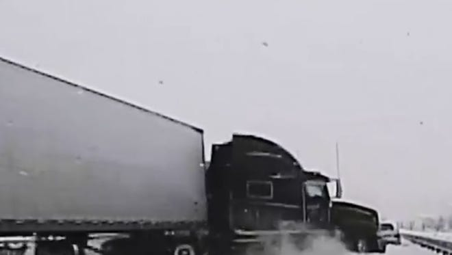 Dashcam footage shows a wreck on icy Montana roads with a runaway semi and a family car.