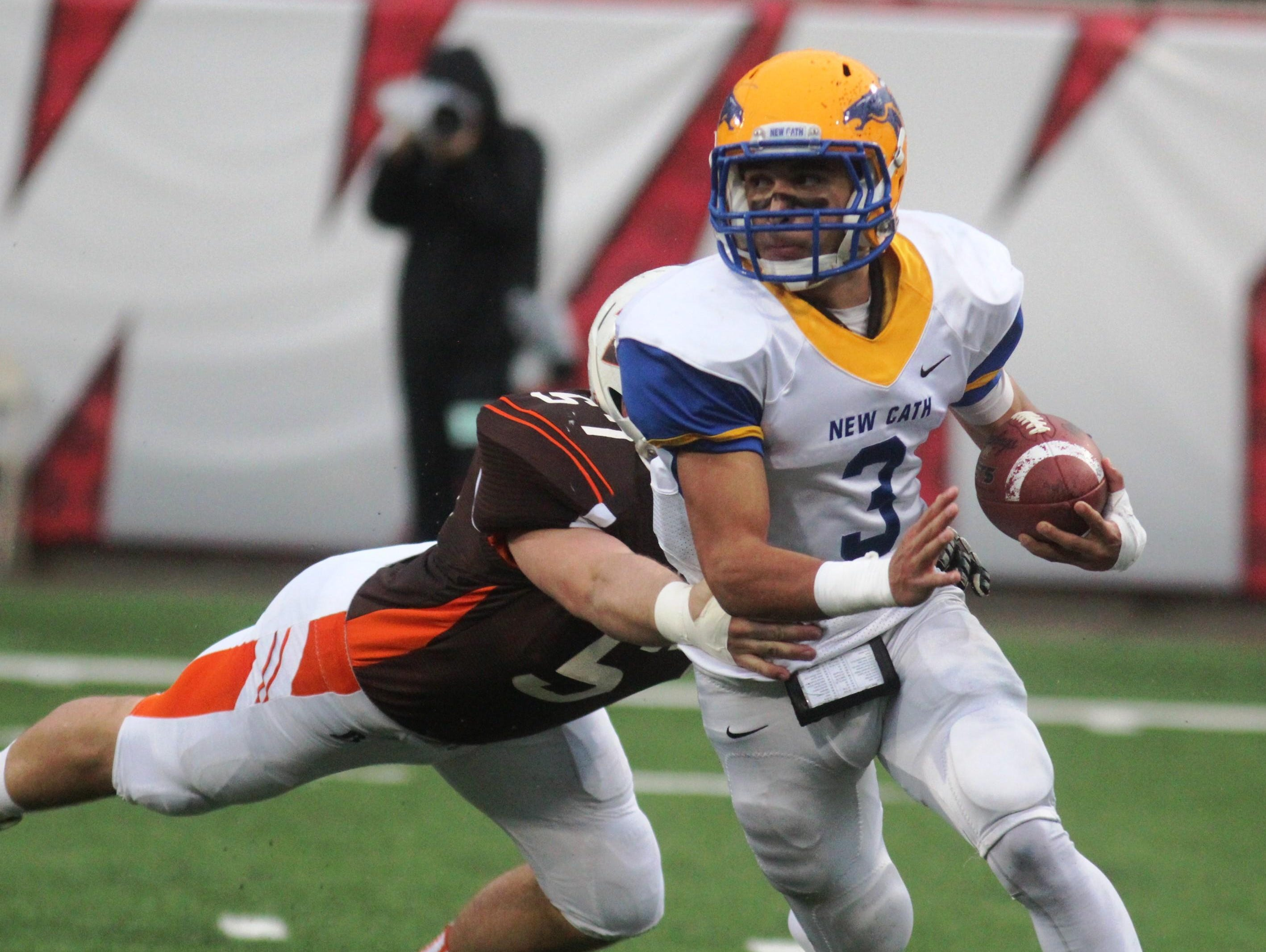 Newport Central Catholic's Jacob Smith carries the ball in last season's 2A state championship game.
