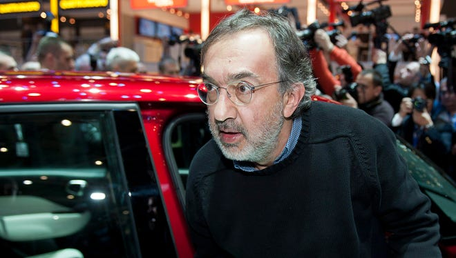 File photo of Chrysler and Fiat CEO Sergio Marchionne leaving a car the Geneva Motor Show last year.
