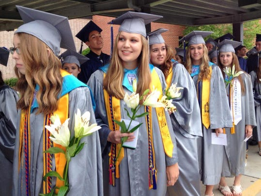 Senior Emma Kindschuh peers around to look at the front of the line before New Oxford's commencement ceremony June 2.