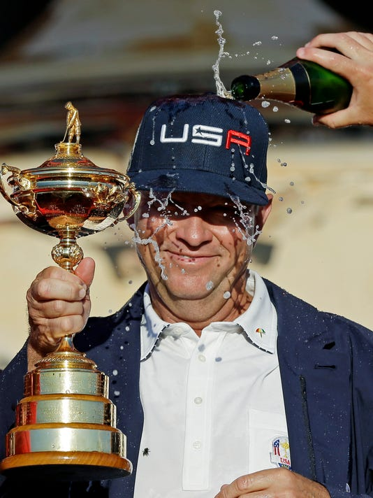 United States captain Davis Love III celebrates during the closing ceremony of the Ryder Cup golf tournament Sunday, Oct. 2, 2016, at Hazeltine National Golf Club in Chaska, Minn. (AP Photo/David J. Phillip)
