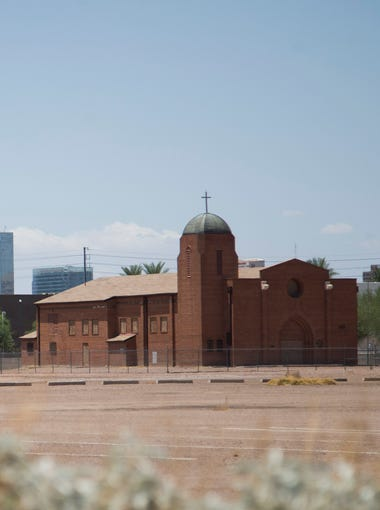 The historic Sacred Heart Church sits surrounded by empty space at 16th Street and Buckeye Road in Phoenix on July 16, 2017.