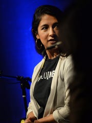 "Panelist Nayra Pacheco, an outreach coordinator at Just Communities, speaks during ""Undocumented Under Trump"" on Wednesday night at the Oxnard College Black Box Theater."