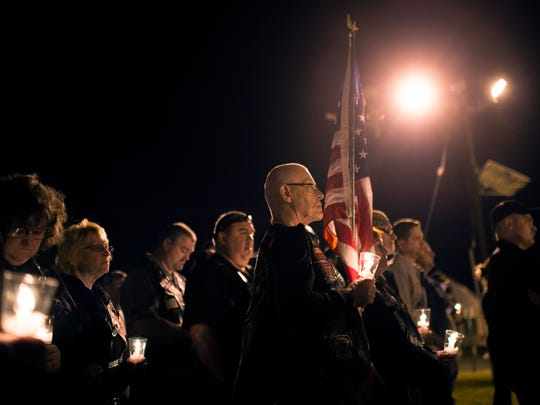 Community members, friends and family gather for a vigil honoring fallen New Jersey State Trooper Sean Cullen Thursday night, March 10 in Westampton.