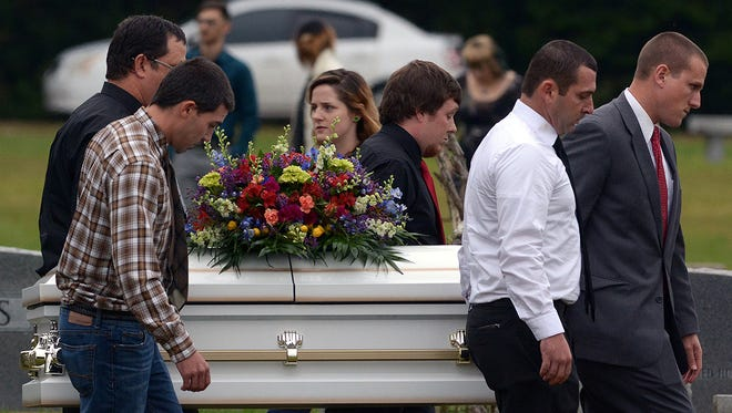 Pallbearers carry the casket of  6-year-old Jeremy Mardis to the grave site at Beaumont Cemetery in Beaumont, Miss., 30 miles east of Hattiesburg, Monday, Nov. 9, 2015. Jeremy Mardis, a 6-year-old autistic boy, was killed and his father wounded when marshals opened fire on their vehicle in Marksville, La. on Nov. 3. Louisiana State Police announced late Friday that they had arrested the two marshals in the shooting.