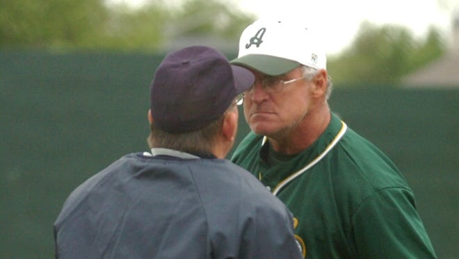 Longtime Acadiana head baseball coach Scott McCullough, right, shown here arguing a call with an umpire during his career with the Wreckin' Rams, will officially have his name on the Acadiana High baseball field in a pregame ceremony at 3:40 p.m. Thursday.