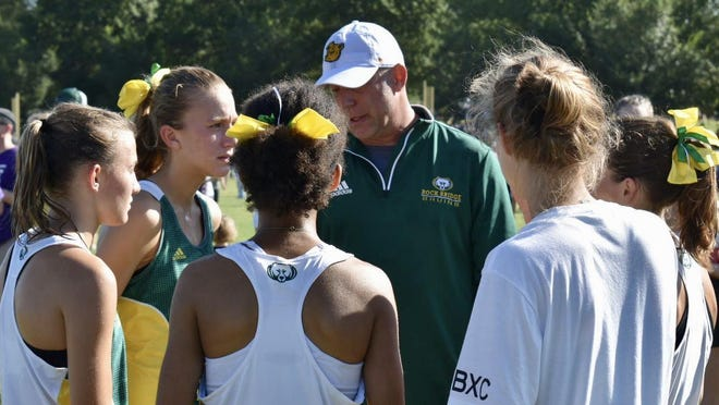 Rock Bridge head cross country coach Neal Blackburn addresses his girls team during a meet this past season.
