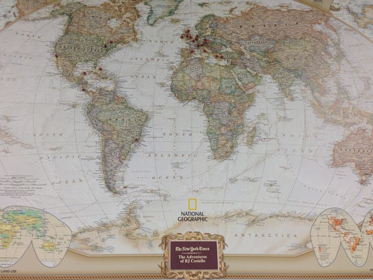 A map of the world hangs in R.J. Costello's office