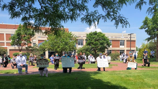 Workers at F.F. Thompson Hospital and the M.M. Ewing Continuing Care Center joined in nine minutes of silence on June 5 to reflect on systemic racism and violence against people of color, both of which are viewed as public health crises.