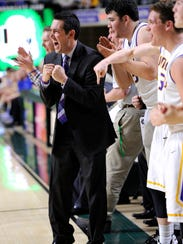 Unioto coach Matt Hoops cheers on his team in the district