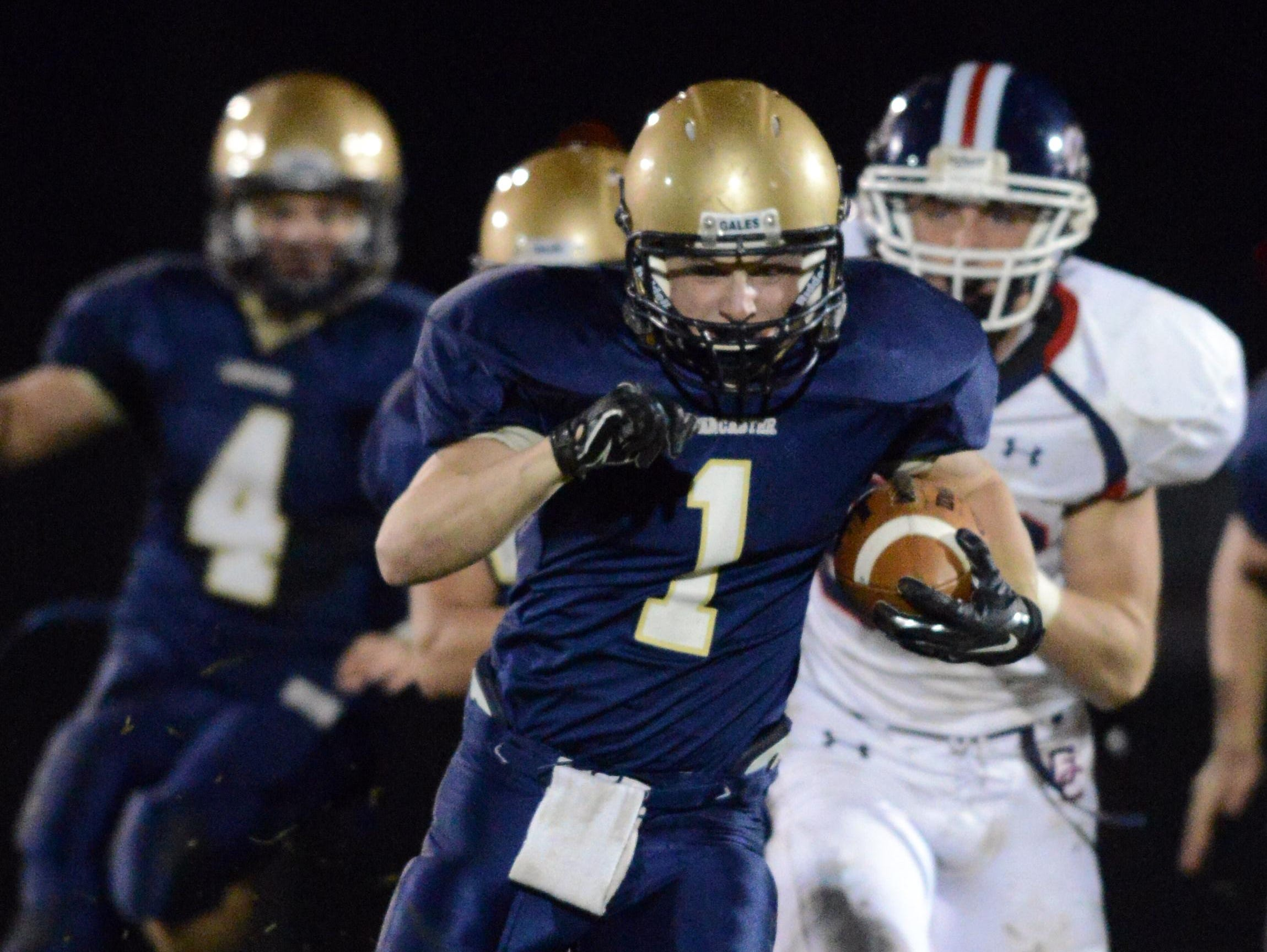 Lancaster's Noah Dryden runs the ball during the Golden Gales' 21-14 win in 2014 over Grove City.