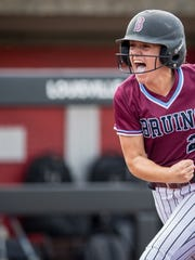Ballard Bruins Allie Skaggs (22) screams as she rounds third base after hitting a home run in the Seventh Region softball tournament semifinals game 1 against the Male Bulldogs at Ulmer Stadium in Louisville, Kentucky, Wednesday, May 03, 2018.