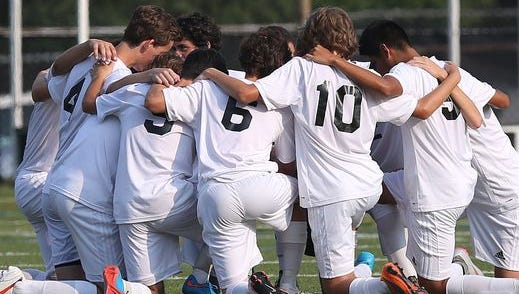 Mamaroneck defeated John Jay East Fishkill 2-1 in sudden death overtime in a boys soccer game at Mamaroneck High School Sept. 3, 2015