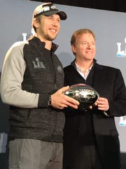 Philadelphia Eagles quarterback and Super Bowl LII MVP Nick Foles accepts the Pete Rozelle Trophy for most valuable player from NFL commissioner Roger Goodell on Monday morning in Bloomington, Minn., at the Mall of America.