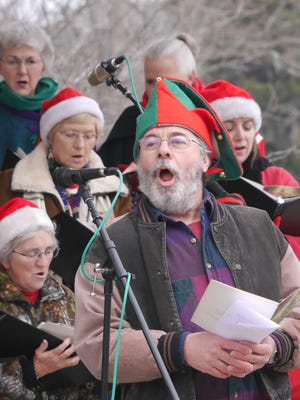 Staunton Choral Society, led Director Raymond Hebert, performs during Caroling in the Park event at Gypsy Hill Park last December. The Staunton Choral on Dec. 20, 2014.