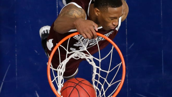 Mississippi State's Craig Sword (32) dunk against Georgia during the second half of an NCAA college basketball game in the Southeastern Conference tournament in Nashville, Tenn., Thursday, March 10, 2016. Georgia won 79-69. (AP Photo/John Bazemore)