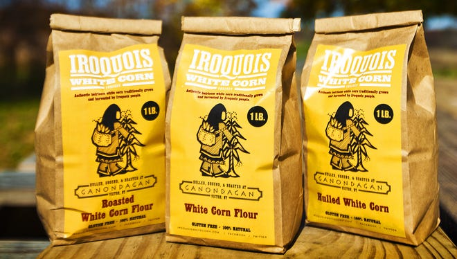 Three 1-pound bags of the Iroquois White Corn Project products. The left is the Roasted White Corn version, the center is the White Corn and the right one is Hulled White Corn. Monday, Oct. 22, 2012.