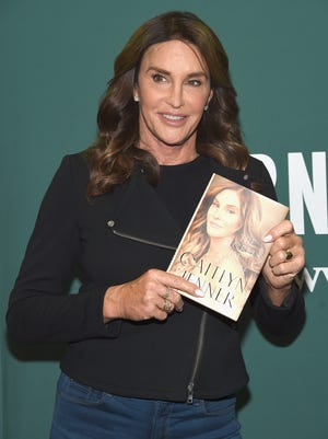 "Caitlyn Jenner displays her memoir ""The Secrets of My Life"" at Barnes & Noble Union Square on April 26 in New York."