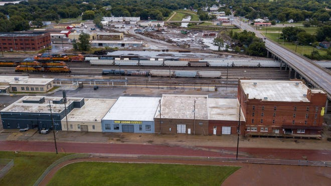 Todd Konkel, a Pottawatomie County resident, purchased six buildings on Adams Street near downtown Topeka about a year ago. He eventually hopes to renovate all of the buildings, which offer a combined 100,000 square feet, but he is starting with the red-brick building at the right, the old Topeka Transfer & Storage Co. warehouse, where he and his wife, Nicolle Konkel, plan to launch the Topeka Vendors Market.