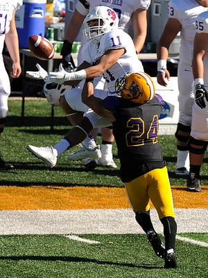 Linfield wide receiver Erick Douglas III pulls in a pass while being defended by Hardin-Simmons defensive back Conlan Aguirre (24) during the third quarter of the Cowboys' 24-10 loss in the first round of the NCAA Division III playoffs on Saturday, Nov. 19, 2016, at HSU's Shelton Stadium.