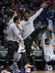 The Suns' Alan Williams reacts to a dunk against the Nuggets during a game in Phoenix earlier this season.
