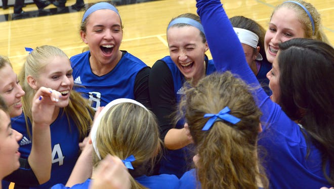 Harper Creek celebrates with teammates after winning the third, and final, set Tuesday night.