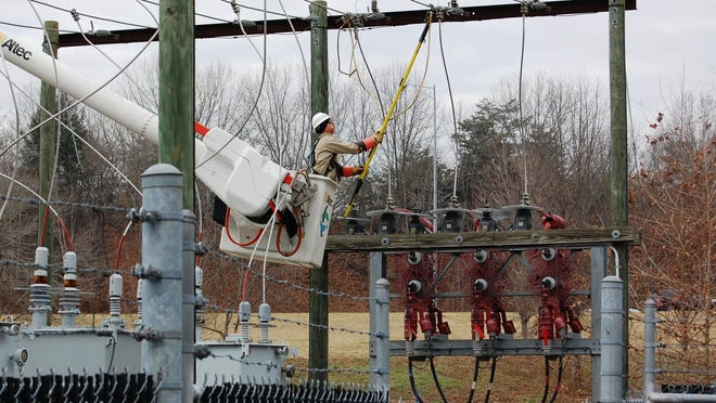 A Duke Energy employee makes repairs at an electrical substation near UNC Asheville last year. Duke Energy plans to build three more substations in downtown and nearby.