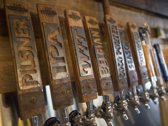 Tap handles line the bar at DC Oakes Brewhouse and