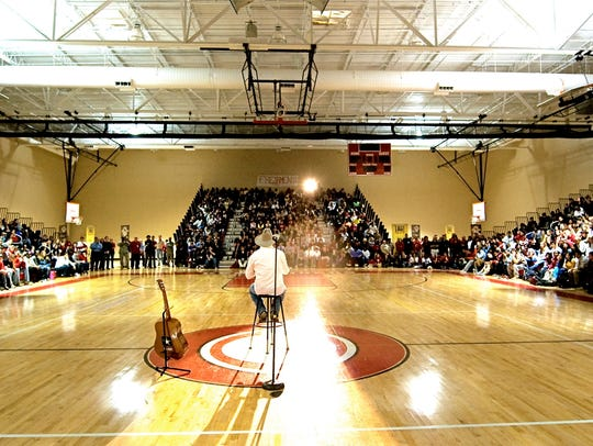 Michael Peterson speaks to an all-school assembly in
