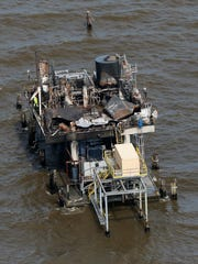 A damaged oil and gas platform stands in Lake Pontchartrain