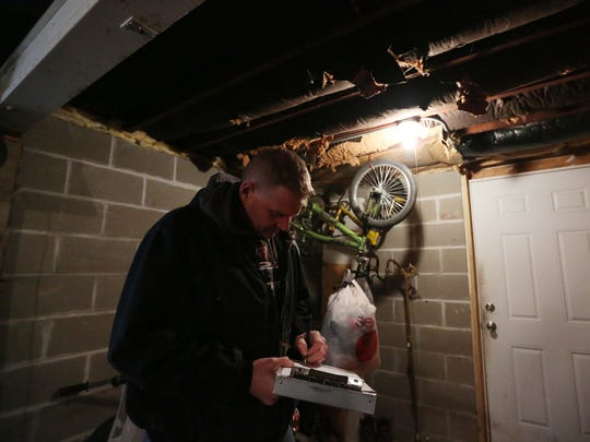 Mike Miller, a city of Des Moines code enforcement officer, with the assistance of Carolyn Schaefer, a registered nurse and healthy homes specialist, inspect a home for environmental causes of asthma on Tuesday, March 1, 2016, in Des Moines. Schaefer looks at things like vents and flooring and Miller puts together a bid for the cost of changes to the home.