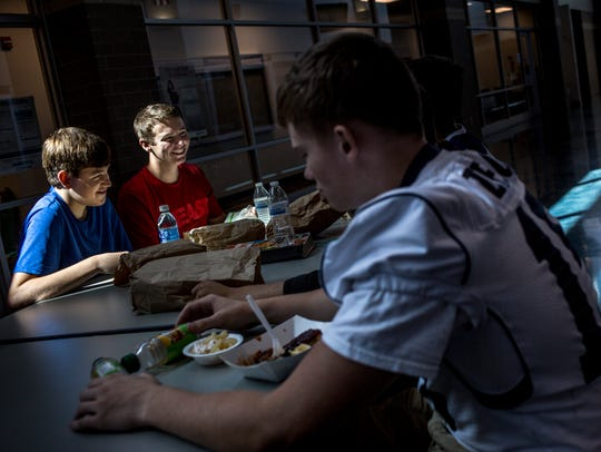 David Sherman and Josh Hude, both 15, eat lunch with